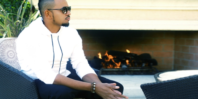 Chris Stokes by the Fireplace